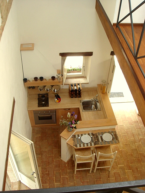 Looking down on the kitchen and breakfast bar from the mezzanine above