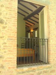 The main bedroom has double doors with balustrade overlooking the garden